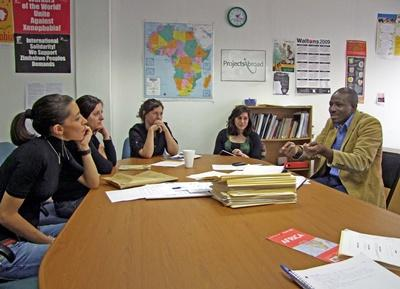 Teen volunteers on the Law & Human Rights project in South Africa sit for a meeting with staff