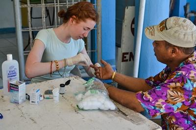 Projects Abroad High School Special volunteer takes blood sugar readings during an outreach in the Philippines, Asia.