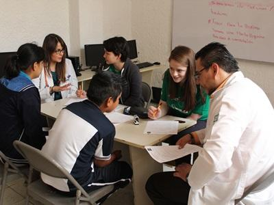 High School Special volunteers talk to patients under the supervision of local doctors at a medical outreach in Mexico.