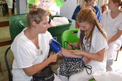High School Special volunteers practice reading blood pressure readings to prepare for a medical outreach in Jamaica.