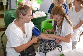 Public Health High School Special students learn how to take vital signs in Jamaica.