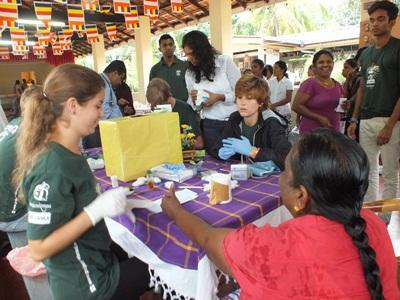 A group of Projects Abroad volunteers participate in a medical outreach for disadvantaged communities in Sri Lanka.