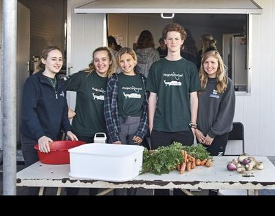 Projects Abroad volunteers doing their high school community service abroad help cook soup at a soup kitchen in Cape Town, South Africa.