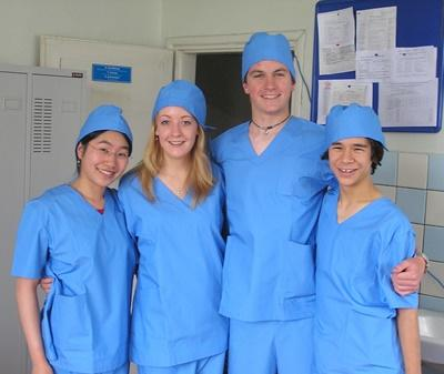 Teen Medicine volunteers dressed in scrubs in a hospital abroad