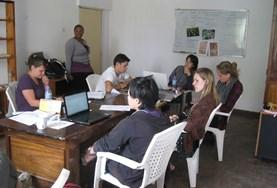 Interns on the Microfinance Internship abroad in Africa, work together with local staff to create business plans.