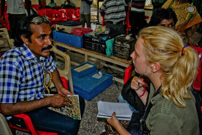A local Indian entrepreneur consults with an International Development intern in India, Asia