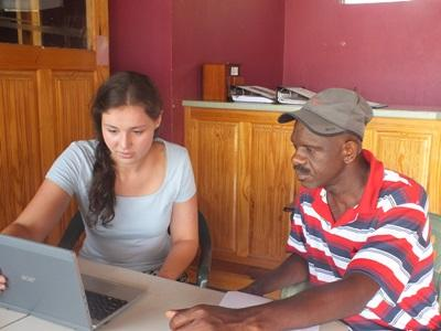 Disaster Management intern assists a Richmond local with a community Disaster Preparedness Plan in Jamaica.