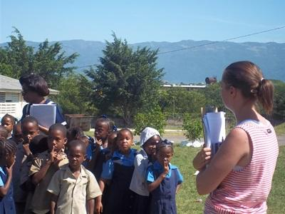 A Disaster Management intern works with children from communities affected by natural disasters in Jamaica.