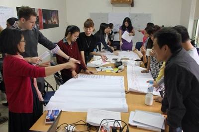 Projects Abroad International Development interns in Vietnam discuss launching a new initiative for a local NGO.
