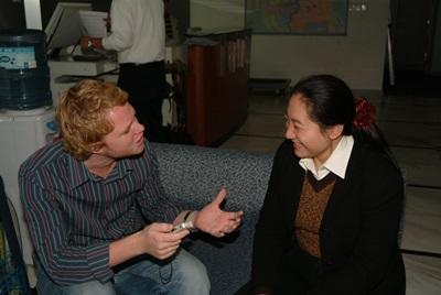 Projects Abroad Journalism intern discusses story ideas with a local journalist in China.