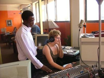 Intern learns to use radio equipment on the Journalism project in Ghana