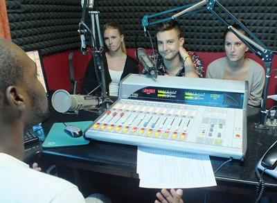 Interns on the Journalism Project learn how to use the studio equipment at a radio station in Jamaica.
