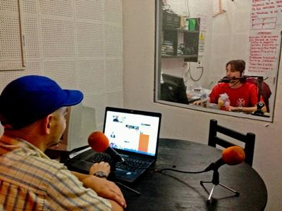 Projects Abroad Journalism interns record a radio broadcast at a station in Argentina.