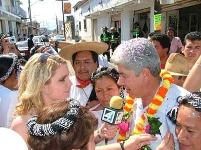 Projects Abroad Journalism interns conduct radio interviews with local people during a street festival in Mexico.