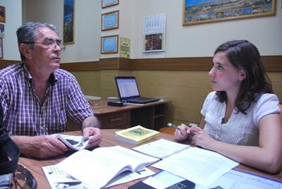 A Projects Abroad Journalism intern discusses ideas for articles to write with a local journalist in Romania.