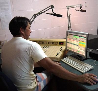 A Projects Abroad Journalism intern gets ready to host a radio show at his internship in Samoa.