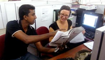 A local journalist explains an assignment to a Projects Abroad Journalism intern in Sri Lanka.