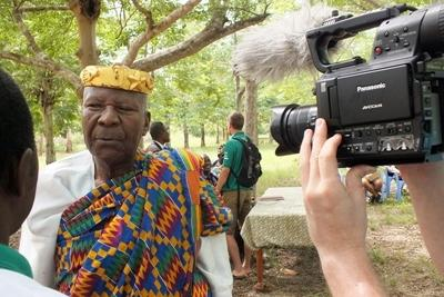 Projects Abroad Journalism intern interviews a local man as part of her work at her internship in Togo.
