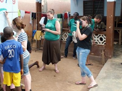 Projects Abroad Journalism interns record events at a community day for an article in Togo.