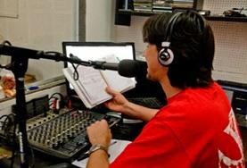 A volunteer works at a local radio station during his Journalism Project in Argentina.