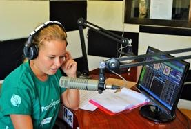 A student volunteer on the Philippines Journalism Internship learns how to produce and run a live radio show.