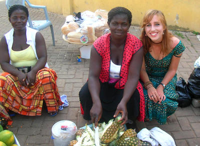 A Projects Abroad volunteer learns about local cuisine with her host family in Ghana.