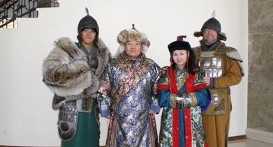 Volunteer dressed in traditional Mongolian clothing to learn the local culture
