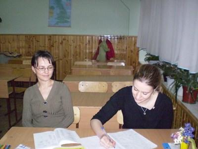 A Projects Abroad volunteer practices Romanian with her language teacher in Romania.