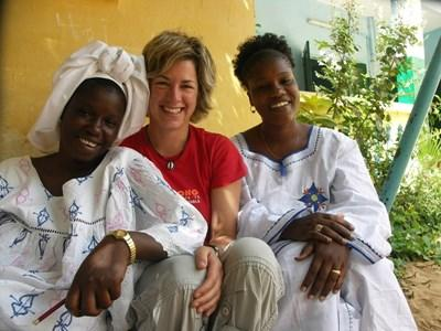 A Projects Abroad volunteers uses her new Wolof language skills to communicate with local women in Senegal.