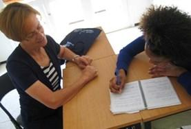 A volunteer takes a Romanian language lesson.