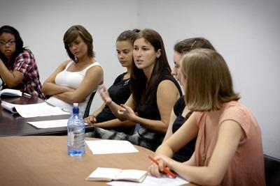 A group of Projects Abroad Law interns discuss a difficult case with local lawyers in a developing country.