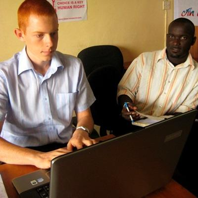 A Human Rights intern consults with a local lawyer about a case in Ghana.