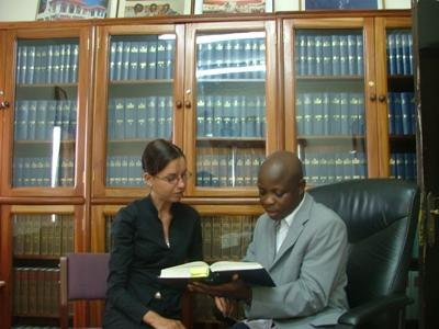 A Projects Abroad intern discusses a legal case with a local lawyer at a firm in Ghana.