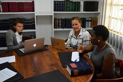Projects Abroad Human Rights interns discuss legal matters with the Human Rights Coordinator at a placement in Arusha, Tanzania.