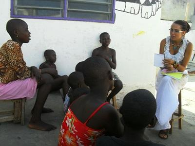 A Human Rights volunteer interviews people in the community to get information for a case in Togo.