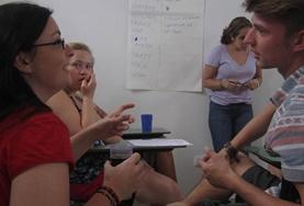Volunteers on the Human Rights Project in Argentina have a meeting with staff.