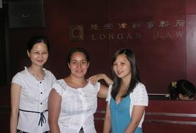 Law interns take a group photo together with their supervisors during their internship in China.