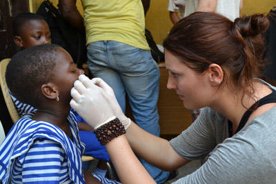 A dentistry student doing her elective in Ghana treats a child during a medical outreach.