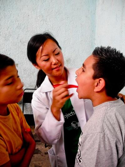 A local child gets a checkup with a student doing her Dentisty Elective in Mexico.