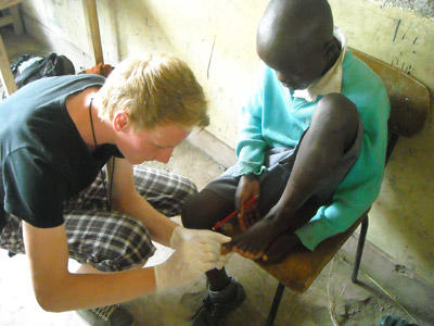 A medical student doing his elective in Kenya treats a child during an outreach.