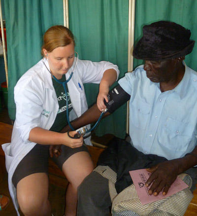 A local woman gets  a check up from a medical student doing her elective in Tanzania.