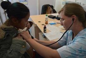 A Mongolian child is examined by a Medical School Elective student working at his volunteer placement.