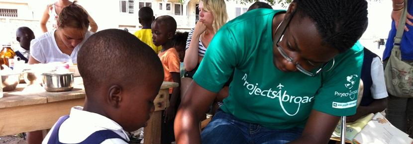 A srtudent doing her Nursing School Elective abroad works with patients at an outreach.