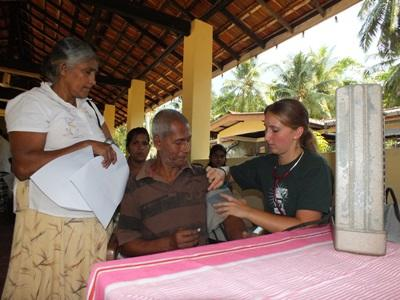 A nursing student doing her elective in Sri Lanka participates in a medical outreach in a rural area.