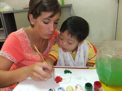 A local child with special needs is helped by an Occupational Therapy Elective student in Morocco.