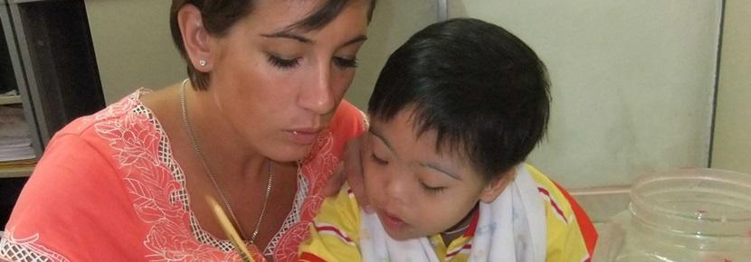 A student doing her Occupational Therapy Elective abroad works with a child who has special needs.