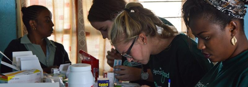 Pharmacy Elective students assist with dispensing medication during an outreach abroad.