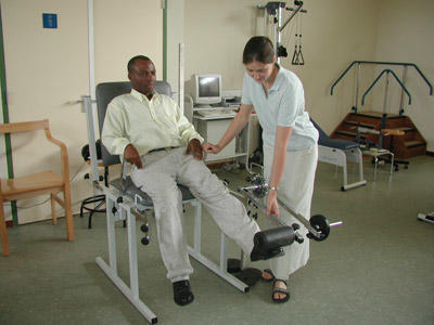 A Physiotherapy Elective student assists a local therapist with patient treatment at a hospital in Ghana.