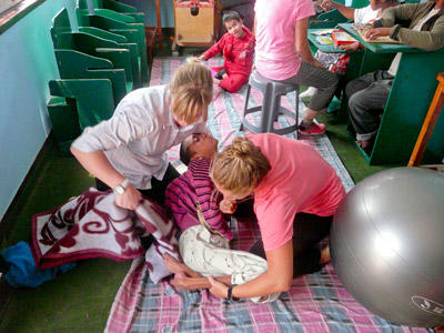 Two Physiotherapy Elective students work with a young child at a special needs centre in Morocco.
