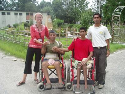 A physiotherapist volunteering abroad spends time with two of the children she treated in Nepal.